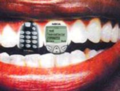 Сотовый можно вмонтировать в зуб